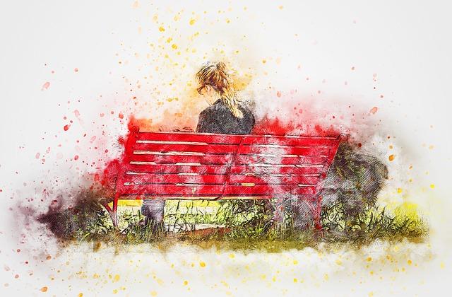 دختر نشسته روی صندلی قرمز